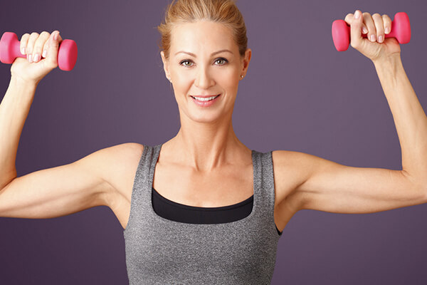 woman lifting arms
