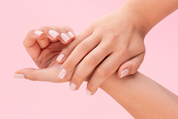 hands in pink background