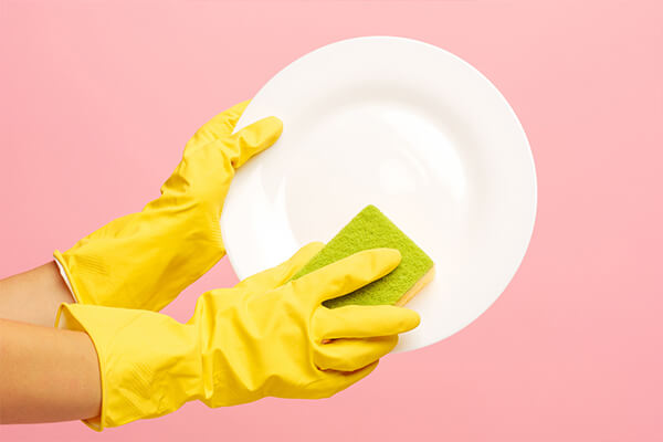 washing dishes wearing gloves