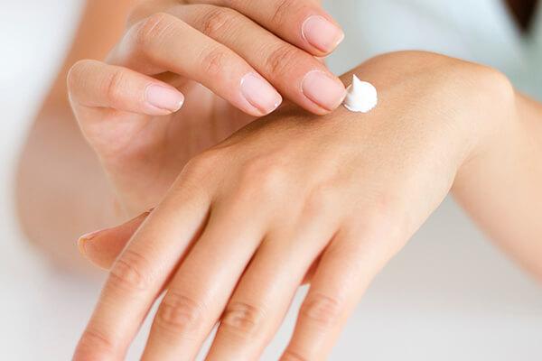 putting cream on hands