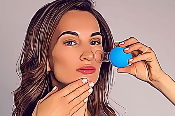 woman using facial cups