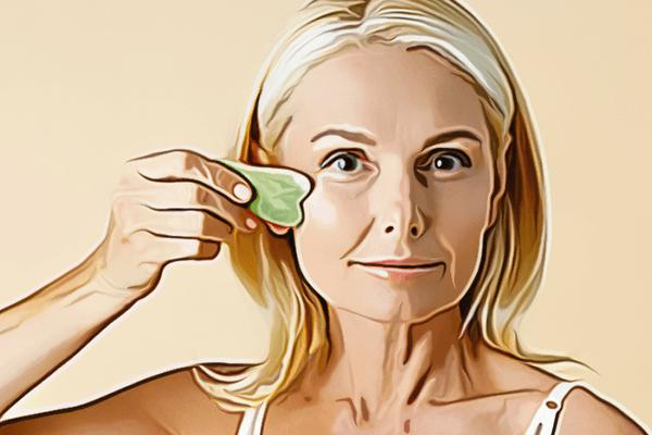 woman using gua sha